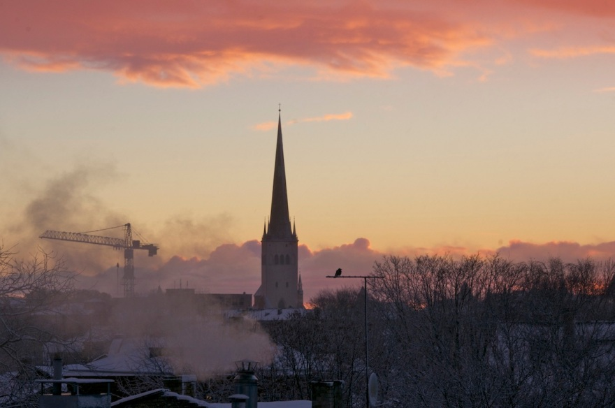 Sunrise in Kalamaja. St Olaf's Church, construction works and smoke.